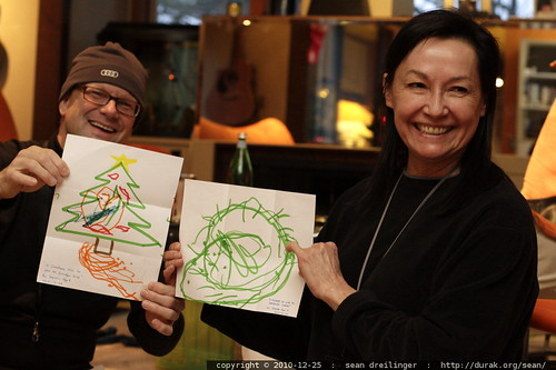 grandparents with xmas drawings from their youngest grandson