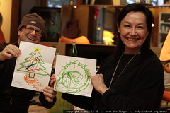 grandparents with xmas drawings from their youngest …