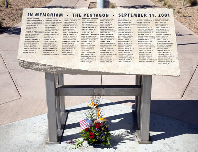 Pentagon Memorial in front of the National Security Sciences Building at Los Alamos National Laboratory. The fragment from a portion of the Pentagon damaged by the 9/11 terrorist attack bears the names of those victims who died at the Pentagon.