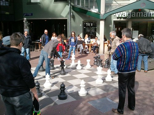 People playing giant chess