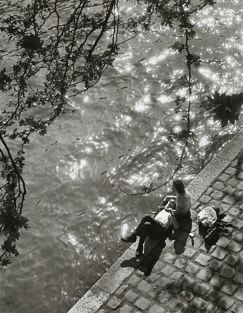 A young couple enjoying lunch on the Right Bank of the Seine, just below Notre Dame, Paris, by Alfred Eisenstaedt 1963