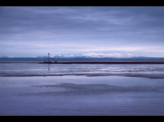 Snow topped hills of Wales, from Crosby beach. Explored Frontpage