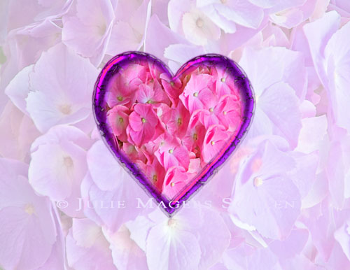 A card of flower petals in the shape of a pink heart.