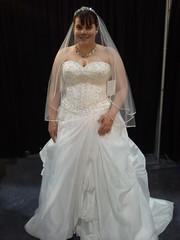 quinceaã±era(0.0), bride(1.0), veil(1.0), bridal clothing(1.0), bridal veil(1.0), gown(1.0), clothing(1.0), fashion(1.0), wedding dress(1.0), dress(1.0),