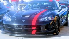 muscle car(0.0), automobile(1.0), automotive exterior(1.0), wheel(1.0), vehicle(1.0), performance car(1.0), automotive design(1.0), bumper(1.0), land vehicle(1.0), luxury vehicle(1.0), srt viper(1.0), supercar(1.0), sports car(1.0),