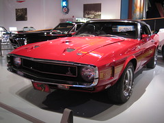 boss 429(0.0), automobile(1.0), automotive exterior(1.0), vehicle(1.0), performance car(1.0), automotive design(1.0), ford mustang mach 1(1.0), auto show(1.0), first generation ford mustang(1.0), antique car(1.0), land vehicle(1.0), muscle car(1.0), sports car(1.0),