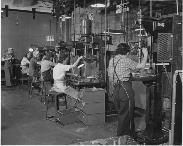 Women man America's machines in a west coast airplane factory...05/1942