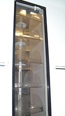 furniture(0.0), refrigerator(0.0), door(0.0), kitchen appliance(1.0), display case(1.0), glass(1.0), lighting(1.0),