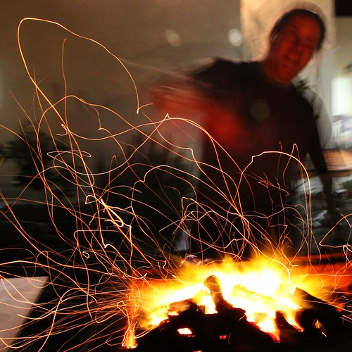 longexposure male night fire person movement gaby bbq grill barbecue heat glowing ember coal sparks spark bernstein slowshutterspeed colorphotoaward bernsteingaby gabybernstein mygearandme