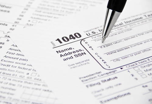 Tax writing, IRS 1040 Tax Form Being Filled Out