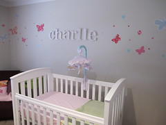furniture(1.0), wall(1.0), room(1.0), infant bed(1.0), mural(1.0), bed(1.0), interior design(1.0), nursery(1.0), pink(1.0), baby products(1.0),