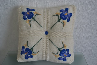 knitted cushion with embroidered Iris and fresia