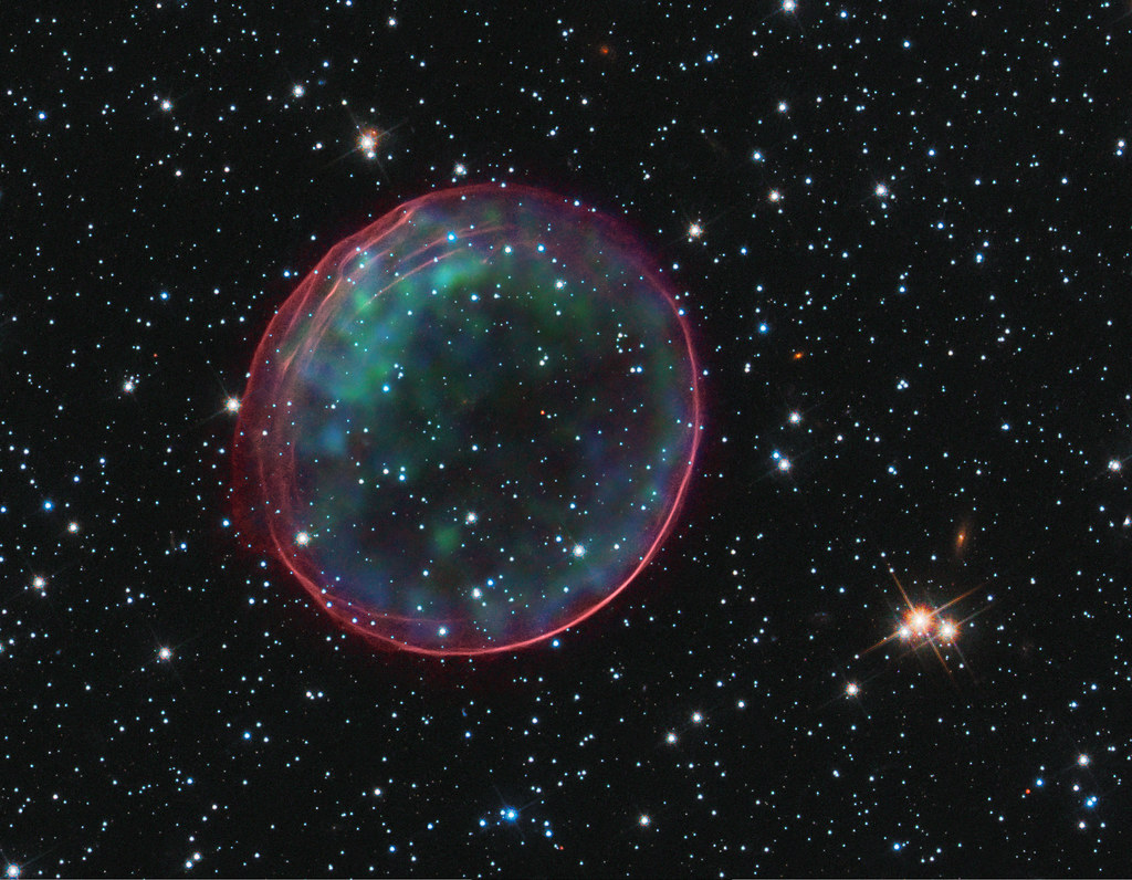 Supernova Bubble Resembles Holiday Ornament: A supernova in the Large Magellanic Cloud, which lies about 160,000 light years from Earth.