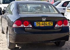 coupã©(0.0), honda civic(0.0), sports car(0.0), automobile(1.0), automotive exterior(1.0), executive car(1.0), wheel(1.0), vehicle(1.0), automotive design(1.0), rim(1.0), honda(1.0), bumper(1.0), honda civic hybrid(1.0), sedan(1.0), land vehicle(1.0),