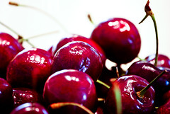 branch(0.0), plant(0.0), christmas decoration(0.0), candy apple(0.0), red wine(0.0), cherry(1.0), red(1.0), produce(1.0), fruit(1.0), food(1.0),