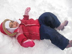play(0.0), toddler(0.0), child(1.0), hand(1.0), footwear(1.0), snow angel(1.0), snow(1.0), pink(1.0),