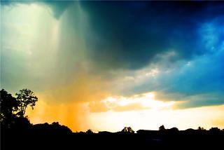 raining under sunset