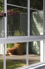 window treatment(0.0), window screen(0.0), porch(0.0), window covering(0.0), interior design(0.0), door(0.0), window(1.0), sash window(1.0), glass(1.0), facade(1.0),