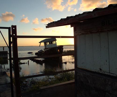 sunset water clouds boat glow humanitarian mozambique quelimane zambézia