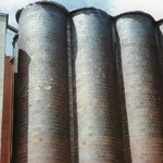 GONE NOW, BUT NOT FORGOTTEN. OLD GRAIN ELEVATORS HAD SOME QUALITY, GLAZED BRICKS.