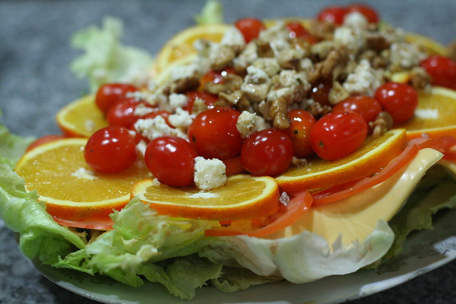 Orange-Lettuce-Tomato salad with Orange-Lime Vinaigrette topped with Feta Cheese and crushed Walnuts
