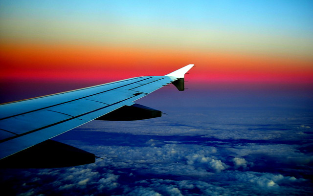Airplane sunset - Flickr CC merajchhaya