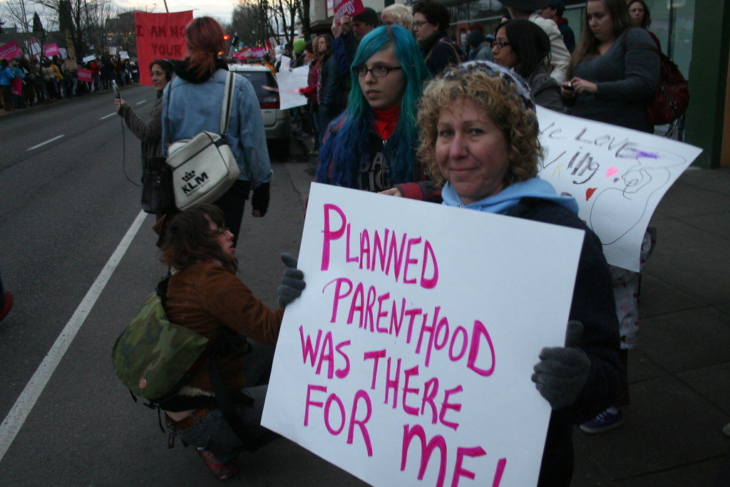 a protester holds a sign reading: Planned Parenthood was there for me