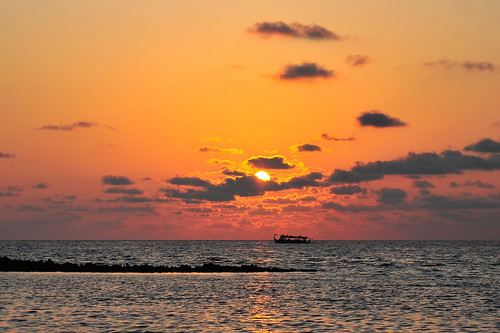 ocean sunset sea orange cloud sun nature water landscape boat ripple indian wave maldives