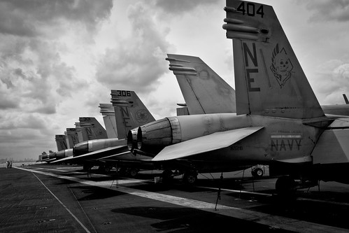 Row of F18s on USS Abraham Lincoln