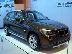 executive car(0.0), bmw concept x6 activehybrid(0.0), automobile(1.0), automotive exterior(1.0), wheel(1.0), vehicle(1.0), automotive design(1.0), compact sport utility vehicle(1.0), bmw x1(1.0), crossover suv(1.0), bumper(1.0), land vehicle(1.0), luxury vehicle(1.0),