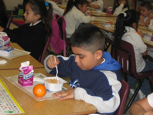 This photo shows a first grader at Reavis Elementary School in Chicago eating breakfast in the classroom. With International School Meals Day and National School Breakfast Week coming up it's a perfect time to talk about how to get more children to eat a nutritious breakfast.
