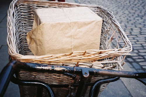 brown paper packages by bicycle