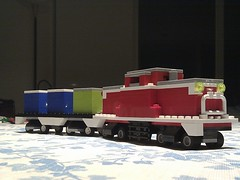 truck(0.0), trailer truck(0.0), scale model(0.0), vehicle(1.0), train(1.0), transport(1.0), freight transport(1.0), locomotive(1.0), rolling stock(1.0), cargo(1.0), land vehicle(1.0), railroad car(1.0), toy(1.0),