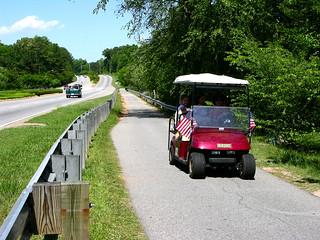 family on a golf cart