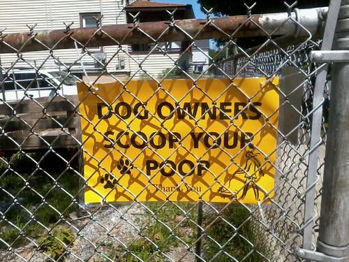 Scoop your poop, you stupid dog owners!!