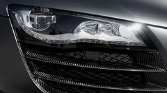 wheel(0.0), rim(0.0), supercar(0.0), automobile(1.0), automotive exterior(1.0), vehicle(1.0), automotive lighting(1.0), automotive design(1.0), light(1.0), grille(1.0), headlamp(1.0), land vehicle(1.0), luxury vehicle(1.0),