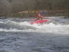 Ollie shooting one of the first rapids on the river Image