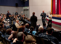 YOKOSUKA, Japan (March 22, 2011) Commander, U.S. Pacific Command, Adm. Robert Willard and his wife Donna Willard listen to a question from a resident during a townhall meeting at Commander, Fleet Activities Yokosuka (CFAY). Willard addressed concerns regarding issues related to the recent disasters in Japan to more than 700 residents at CFAY's Benny Decker Theater. 