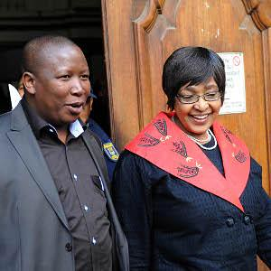 African National Congress Youth League leader Julius Malema and ANC MP Winnie Mandela leaving the Guateng court where Malema was being accused of increasing racial tensions by singing revolutionary songs from the days of the armed struggle in South Africa by Pan-African News Wire File Photos