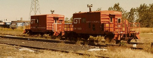 Two Grand Trunk Western Railroad transfer cabooses at the soon to be closed GTW Elsdon Yard. ( Gone.) Chicago Illinois USA. October 1983. by Eddie from Chicago