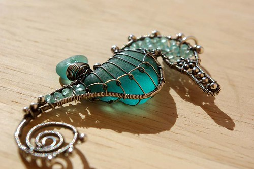 Intense Teal Seahorse wire wrapped sea glass pendant.