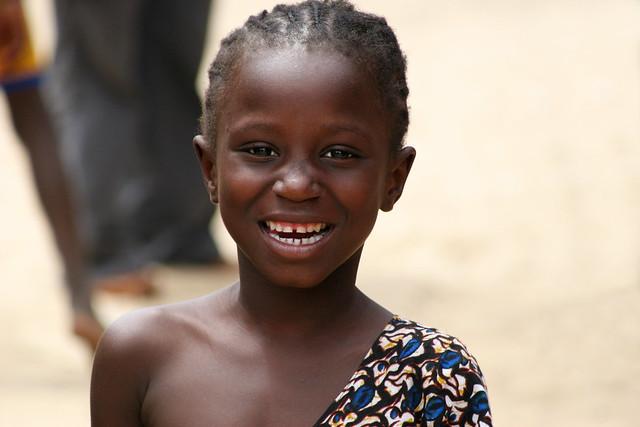 Portrait of a smiling girl in Dakar, Senegal.