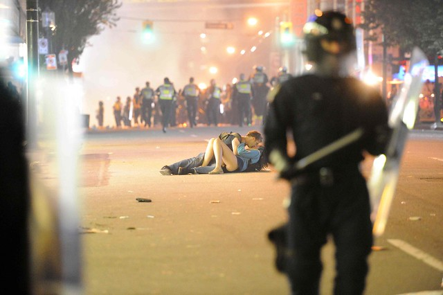 A couple kiss during the Vancouver riots of June, 2011, by Rich Lam