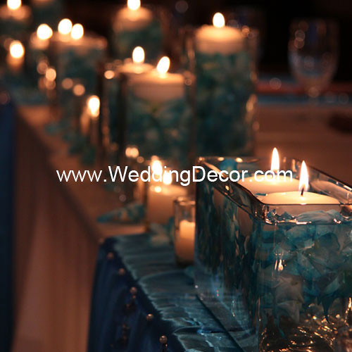 Head table decorations for a wedding reception in blue and ivory with