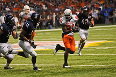 Justin Blackmon runs around Arizona's defenders