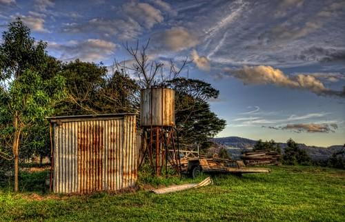 blue sky tree green grass metal high rust iron tank dynamic shed australia kangaroo valley nsw range hdr highdynamicrange corrugated