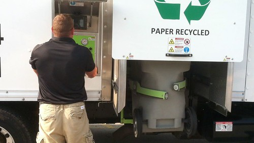 Operator shredding a secure tote of documents | by croweshredding