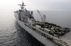 """In the file photo, USSS Harpers Ferry (LSD 49) transits the Pacific Ocean after transferring personnel to an MH-53E Sea Dragon from Helicopter Mine Countermeasure Squadron 14 """"Vanguard"""" (HM 14) during Operation Tomodachi. Harpers Ferry, will be returing to San Diego after swapping crews with USS Germantown in Sasebo, Japan. (U.S. Navy photo by Mass Communication Specialist 1st Class Josh Huebner)"""