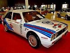 race car, automobile, lancia, vehicle, land vehicle, luxury vehicle, sports car,