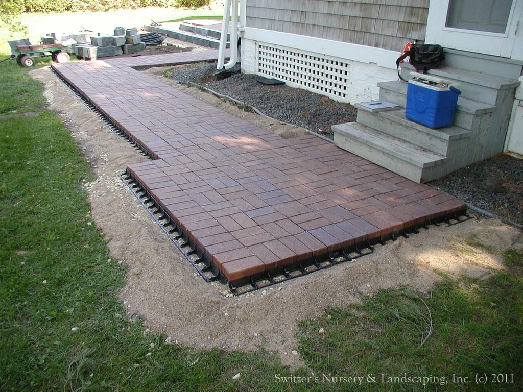 Clay Paver Dinning Patio With Natural Stone Raised Planter And - Raised brick patio